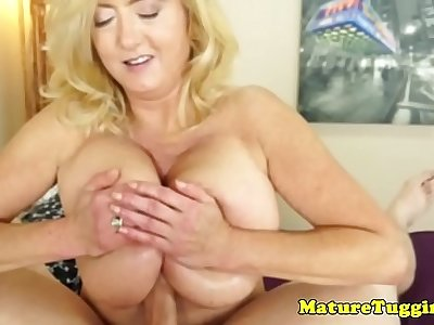 Chubby mature amateur titfucks cock to climax